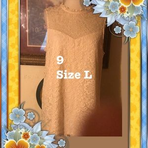 9 lace top cream colored with lining size large